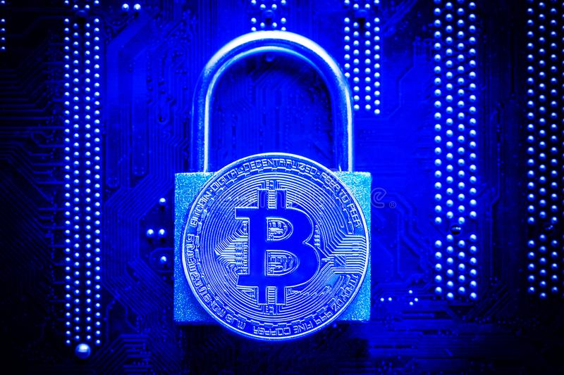 bitcoin-padlock-computer-motherboard-crypto-currency-internet-data-privacy-information-security-concept-blue-toned-image-105736554